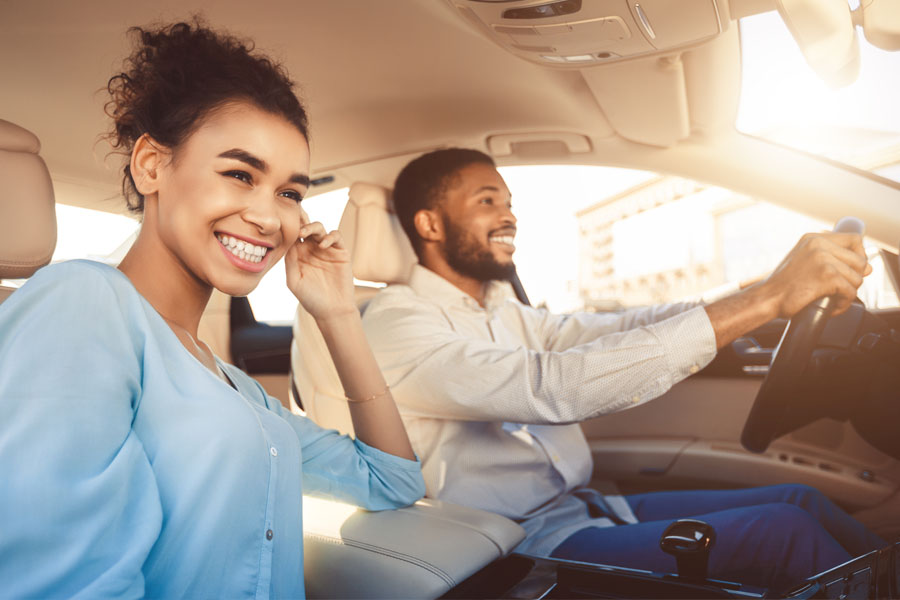 Personal Insurance Young Couple Riding in a Car in Downtown Lancaster