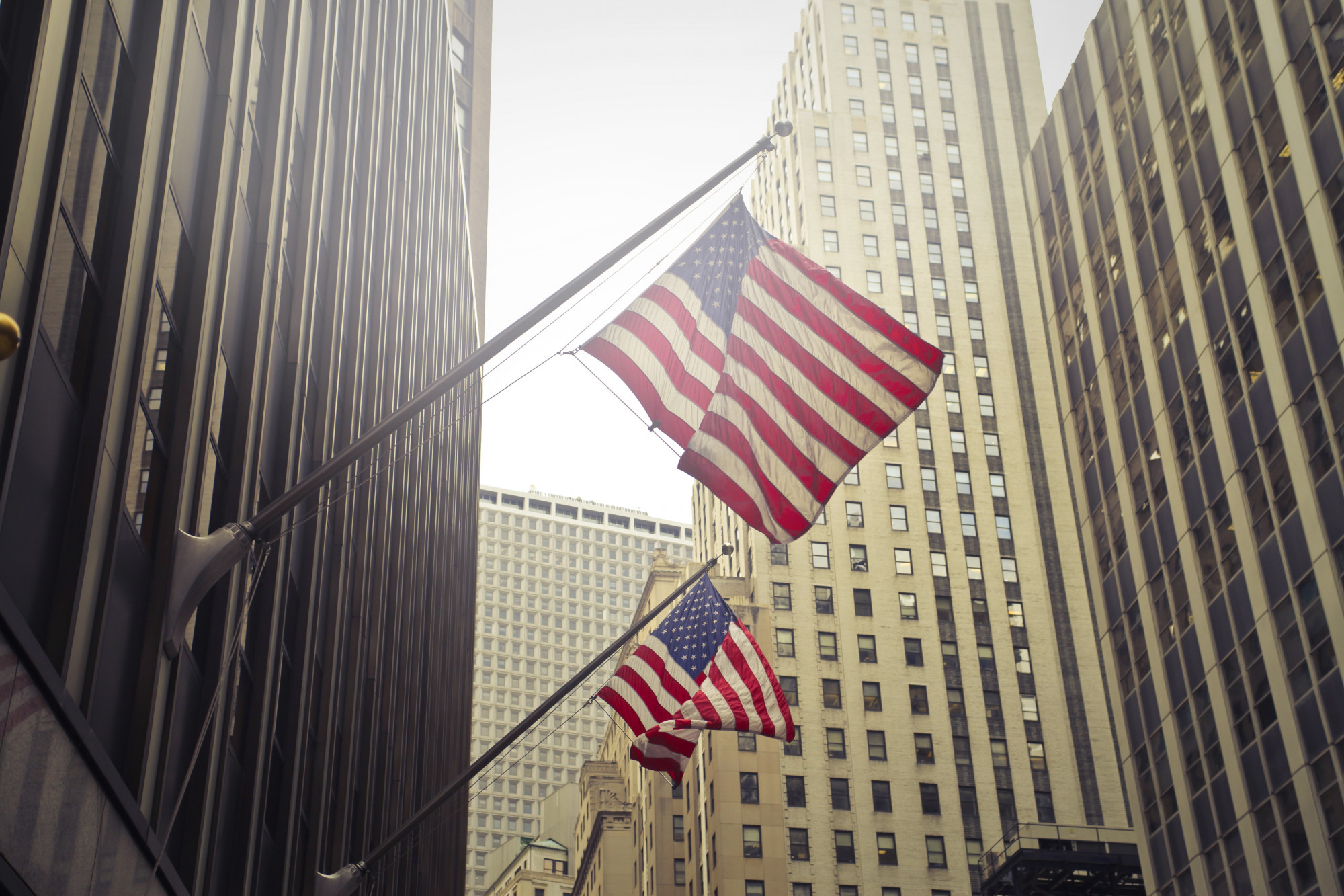 shot two american us flags high rise building